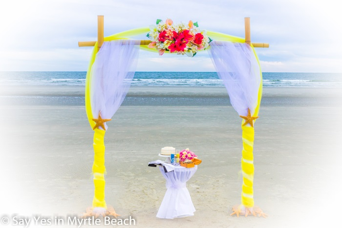 Yellow and white tulle wrapped arbor