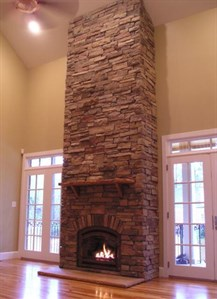 stone fireplace up to the ceiling